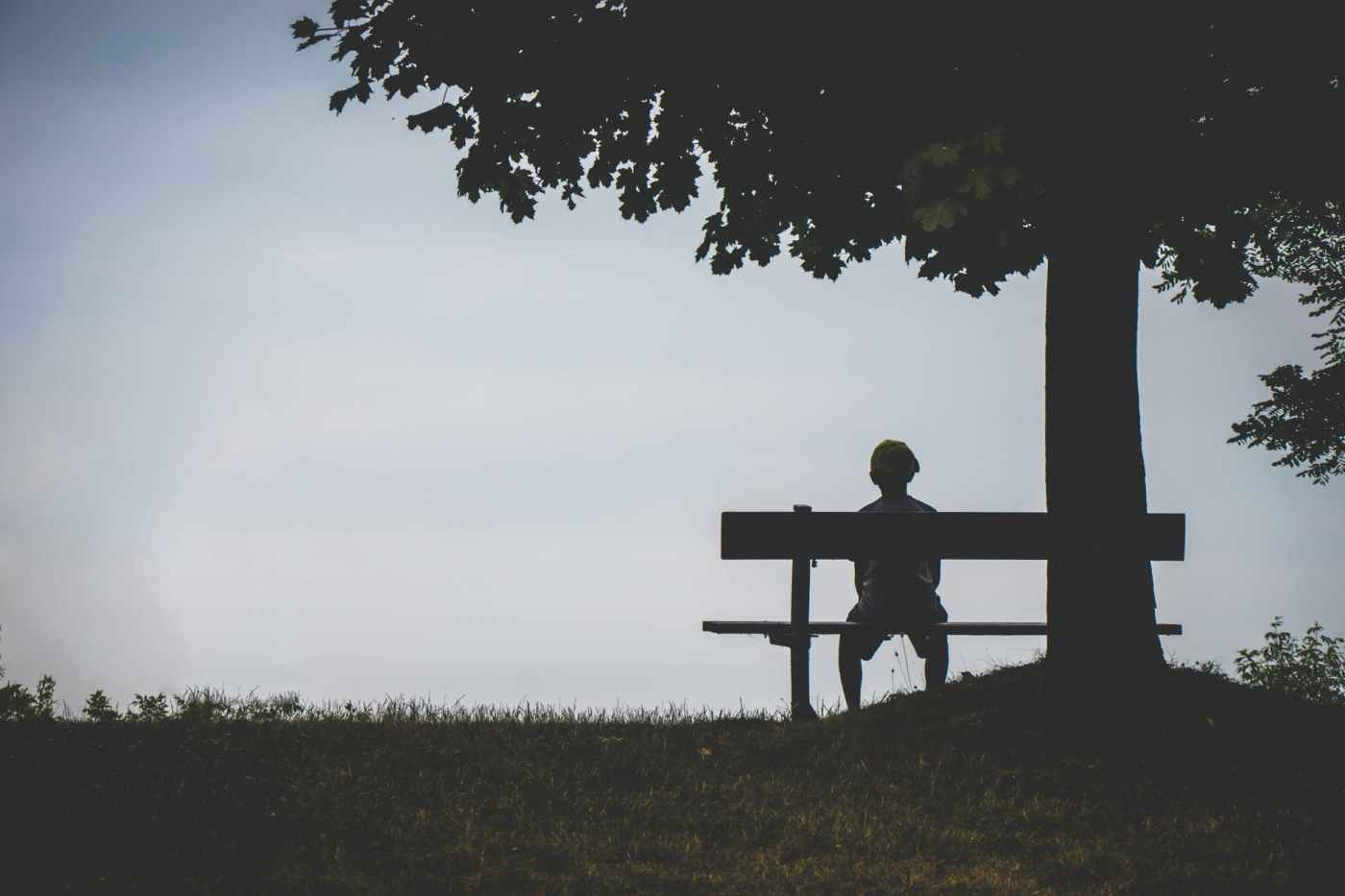 boy on a bench at dusk